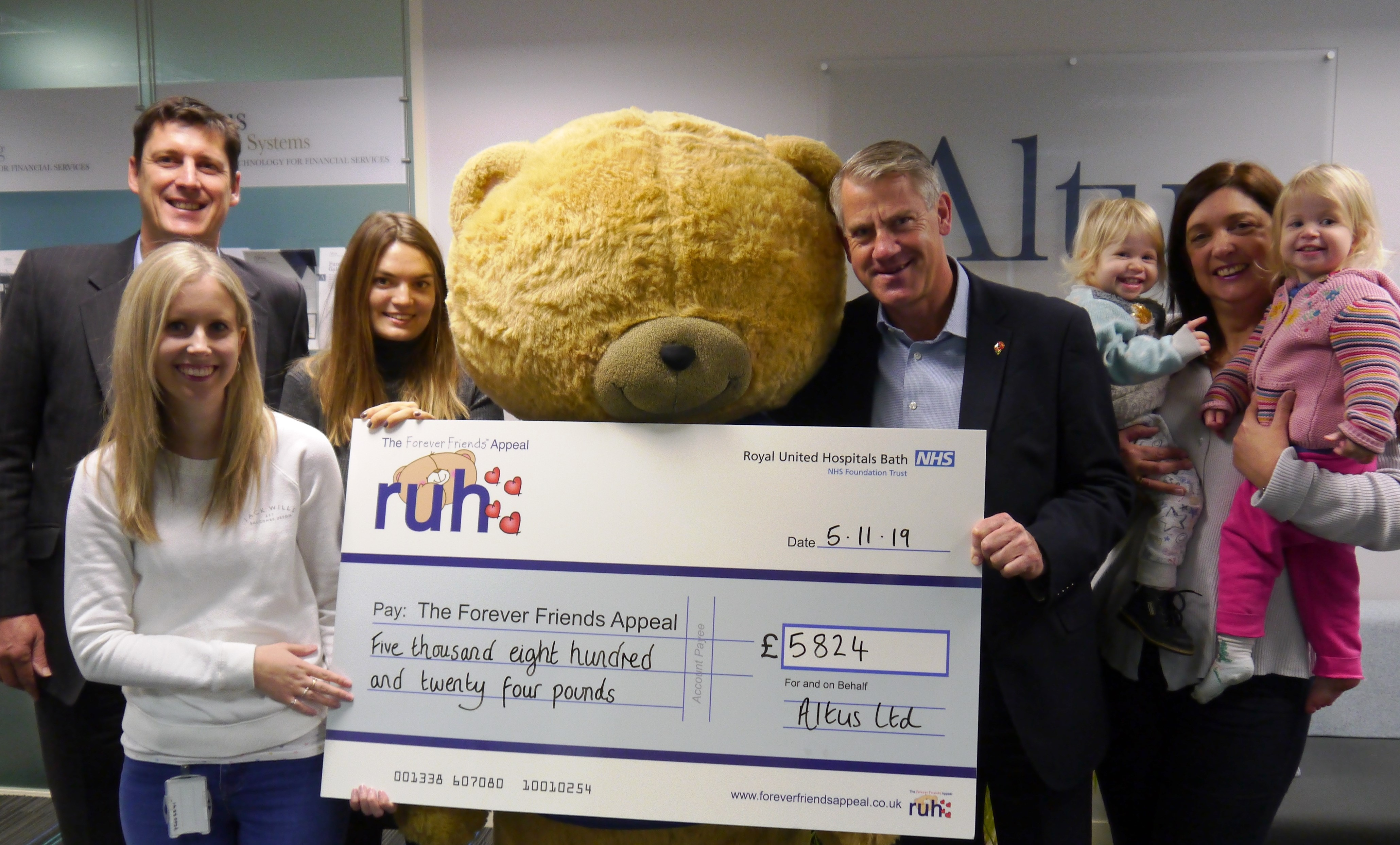 Cheque presentation with Big Ted and the twins.